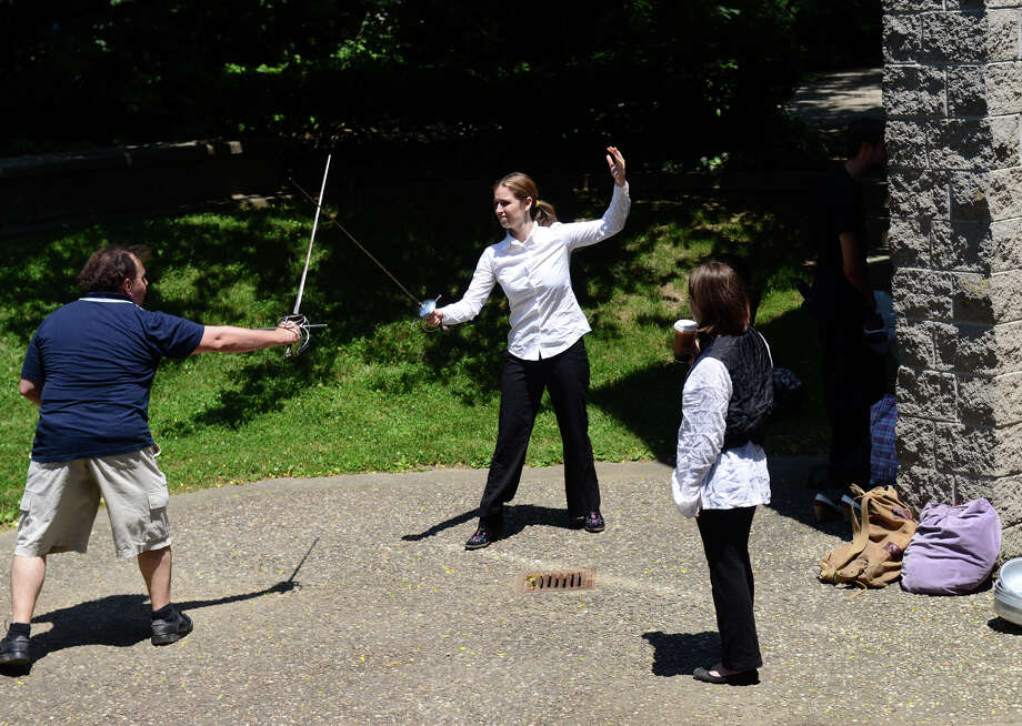 Hudson Shakespeare Company actors Jon Ciccarelli, left, as Cyrano, and Eleah Burman, as Rageneau, rehearse a sword fight before a performance of Shakespeare's Cyrano de Bergerac, held at the Stratford Public Library in Stratford, Conn. on Saturday June 29, 2013. This is the 22nd season of the traveling summer theater. Upcoming shows in July and August will be Henry VIII and Macbeth. More information can be found at: www.hudsonshakespeare.homestead.com Photo: Christian Abraham / Connecticut Post