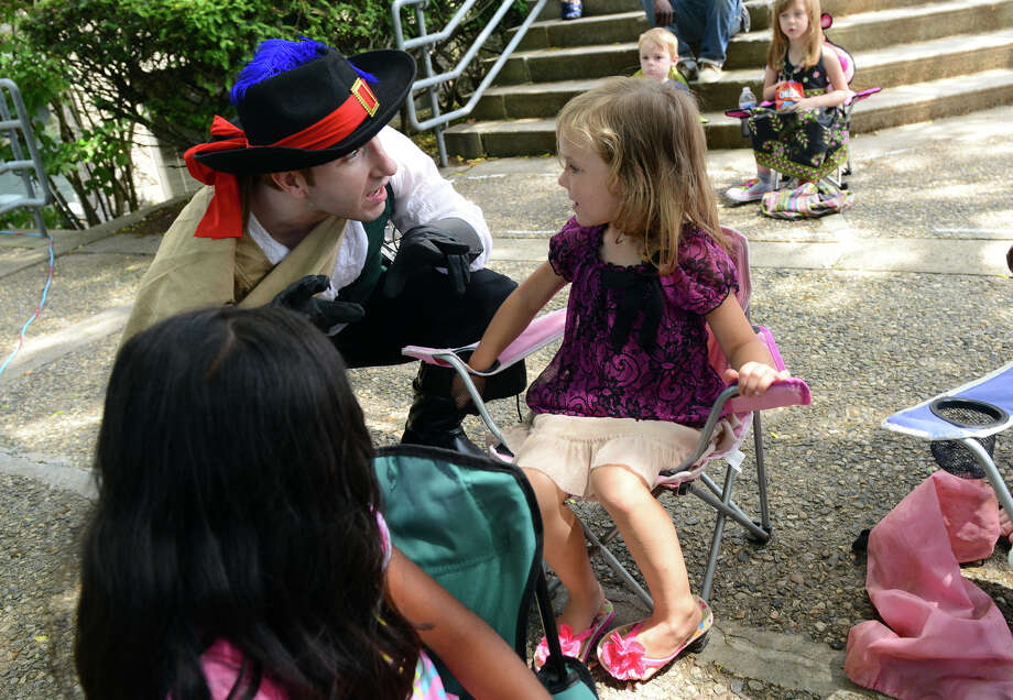 Actor Jeff Deglow, who plays LeBret, asks Twyla Johnson, 5, if she's seen Cyrano during a performance of Shakespeare's Cyrano de Bergerac, held at the Stratford Public Library in Stratford, Conn. on Saturday June 29, 2013. This is the 22nd season of the traveling summer theater. Upcoming shows in July and August will be Henry VIII and Macbeth. More information can be found at: www.hudsonshakespeare.homestead.com Photo: Christian Abraham / Connecticut Post