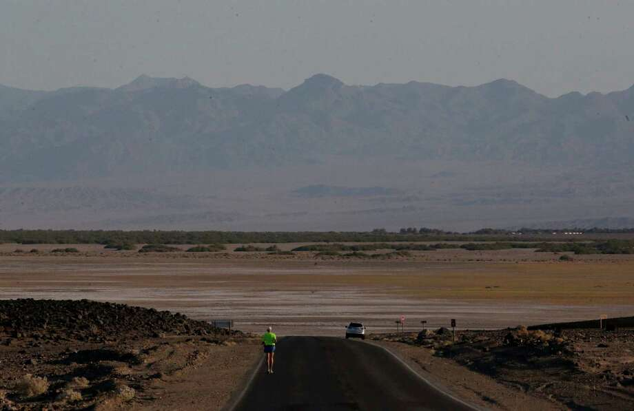 Steve Howard, of Lafayette, La., does a 30 mile training run from Badwater to Furnace Creek in Death Vally National Park Friday, June 28, 2013 in Badwater, Calif. Excessive heat warnings will continue for much of the Desert Southwest as building high pressure triggers major warming in eastern California, Nevada, and Arizona. Photo: Chris Carlson, Associated Press / AP