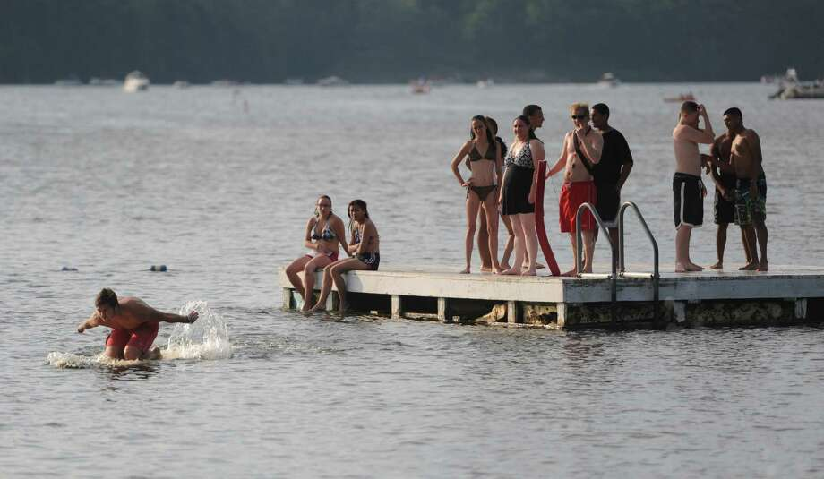 Swimmers hang out on a floating dock before the July 4th fireworks display at Candlewood Lake in Danbury, Conn. on Saturday, June 29, 2013. Photo: Tyler Sizemore / The News-Times