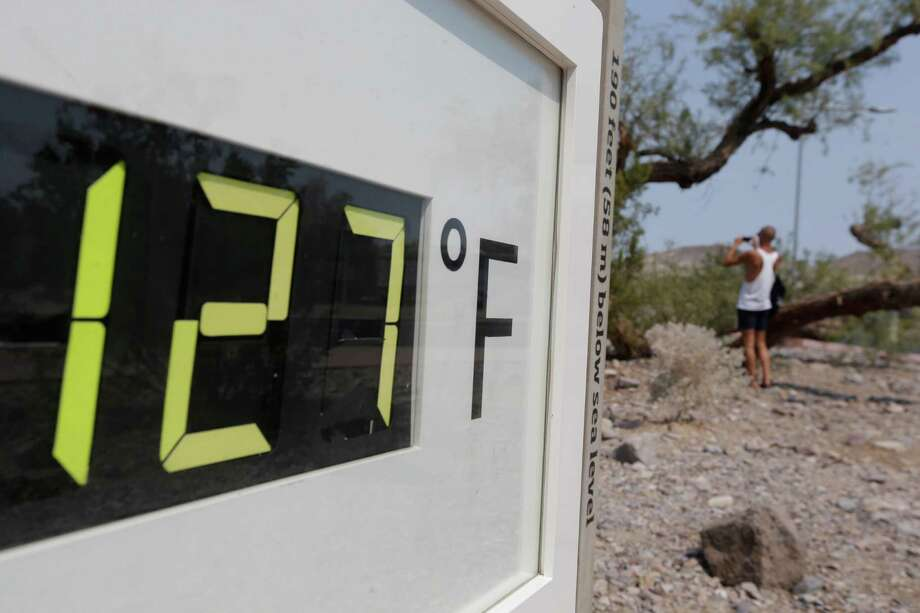 A visitor to the Furnace Creek Vistitor Center walks by a digital thermometer in Death Vally National Park Friday, June 28, 2013 in Furnace Creek, Calif. Excessive heat warnings will continue for much of the Desert Southwest as building high pressure triggers major warming in eastern California, Nevada, and Arizona. Photo: Chris Carlson, Associated Press / AP