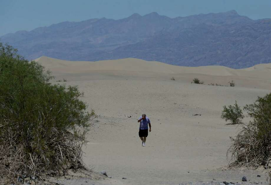 Dan Kail, 67, of Pittsburg Pa., walks thru the sand dunes in Death Vally National Park Friday, June 28, 2013 near Stovepipe Wells, Calif. Excessive heat warnings will continue for much of the Desert Southwest as building high pressure triggers major warming in eastern California, Nevada, and Arizona. Photo: Chris Carlson, Associated Press / AP