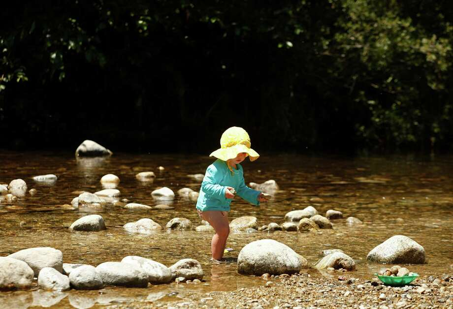 Jett Jameson collects rocks while cooling down in the Carmel River at Dampierre Park in Carmel Valley, Calif. on Thursday June 27, 2013. Photo: David Royal, Associated Press / Monterey County Herald