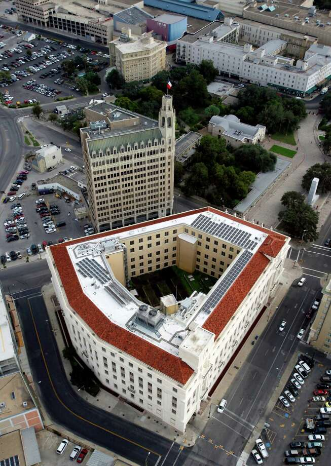 The Hipolito F. Garcia Federal Building and U.S. Courthouse in downtown San Antonio is seen in this Oct. 25, 2012 aerial photo. The Emily Morgan hotel stands next to the federal building while the Alamo can be seen surrounded by trees in the image. The Crocket Hotel and the Menger Hotel are seen at the very top of the image. Photo: William Luther, San Antonio Express-News / © 2012 San Antonio Express-News
