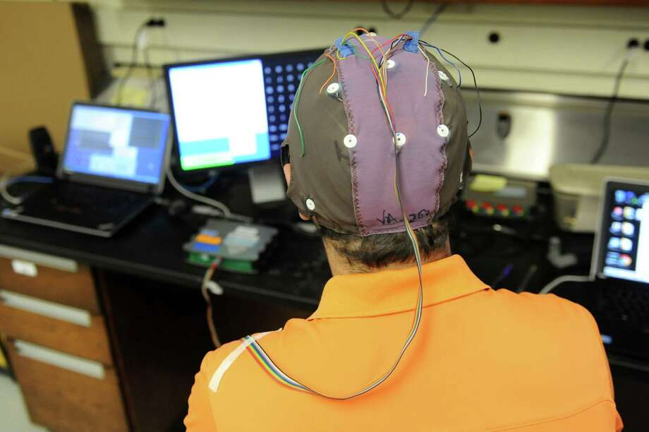 Andrew Wilkinsen wears an electro-cap to write a message with his brain waves while sitting in front of a computer at The Laboratory of Neural Injury and Repair at the Wadsworth Center on Thursday, June 27, 2013 in Albany, N.Y. (Lori Van Buren / Times Union) Photo: Lori Van Buren / 00022998A