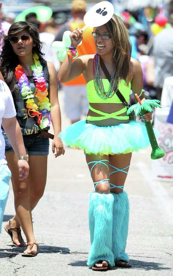 HoustonJanet Rodriguez checks out the Houston Pride Festival on Saturday, June 29, 2013, in Houston. Photo: Mayra Beltran / © 2013 Houston Chronicle