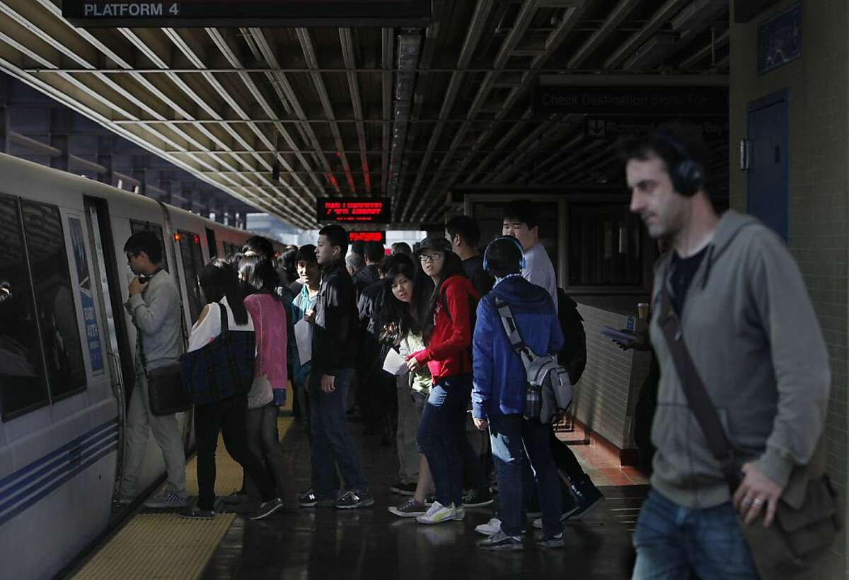 A group of BART passengers prepare to board a train in the morning at MacArthur Station on Wednesday, April 24, 2013 in Oakland, Calif.