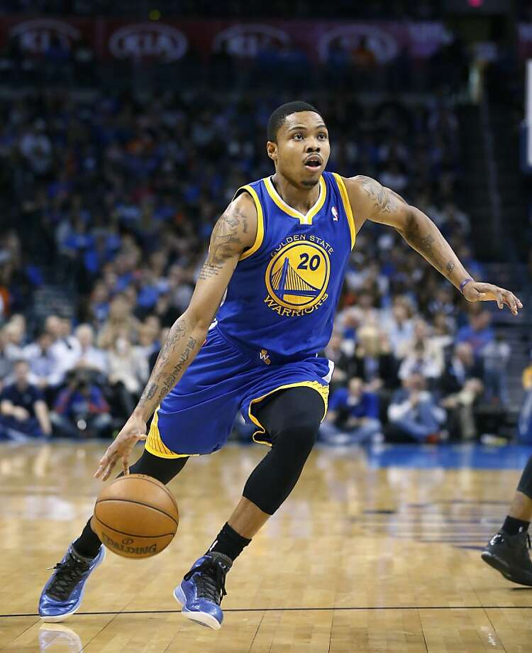 Golden State Warriors guard Kent Bazemore (20) drives against the Oklahoma City Thunder during an NBA basketball game in Oklahoma City, Wednesday, Feb. 6, 2013. (AP Photo/Sue Ogrocki) Photo: Sue Ogrocki, Associated Press