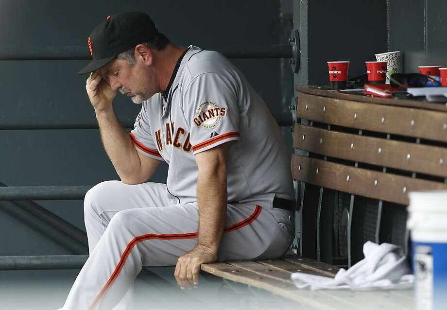 Manager Bruce Bochy watched his Giants fall to their sixth straight loss despite an eight-inning, three-hit gem from Matt Cain. Jeremy Affeldt gave up a run in the ninth inning to take the loss. Photo: David Zalubowski, Associated Press