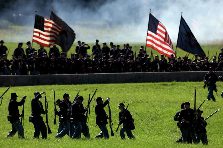 Reenactors take part in a demonstration of a battle during ongoing activities commemorating the 150th anniversary of the Battle of Gettysburg, Saturday, June 29, 2013, at Bushey Farm in Gettysburg, Pa. Union forces turned away a Confederate advance in the pivotal battle of the Civil War fought July 1-3, 1863, which was also the war's bloodiest conflict with more than 51,000 casualties. Photo: Matt Rourke, Associated Press / AP
