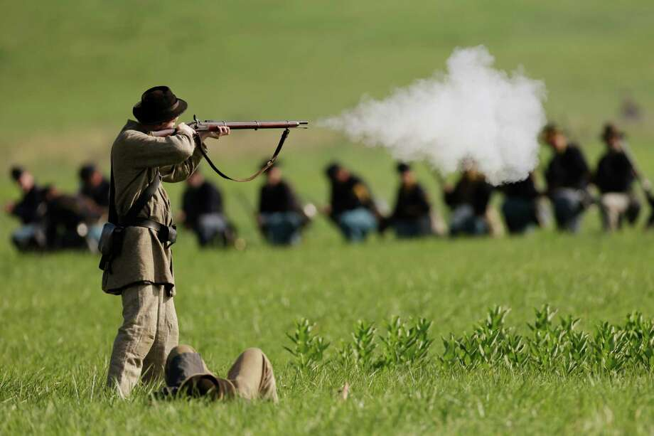 Reenacotrs demonstrate a battle during ongoing activities commemorating the 150th anniversary of the Battle of Gettysburg, Friday, June 28, 2013, at  at Bushey Farm in Gettysburg, Pa. Photo: Matt Rourke, Associated Press / AP