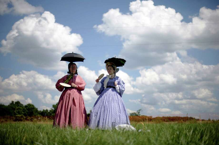 Reenactors watch a demonstration of a battle during ongoing activities commemorating the 150th anniversary of the Battle of Gettysburg, Saturday, June 29, 2013, at Bushey Farm in Gettysburg, Pa. Photo: Matt Rourke, Associated Press / AP