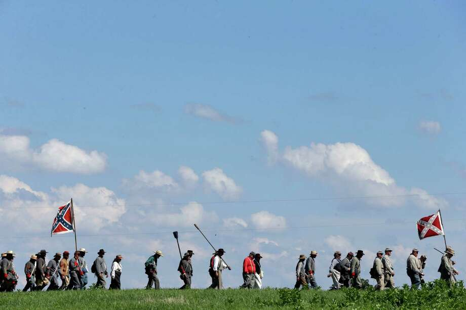 Confederate reenactors march during the demonstration of a battle during ongoing activities commemorating the 150th anniversary of the Battle of Gettysburg, Saturday, June 29, 2013, at Bushey Farm in Gettysburg, Pa. Photo: Matt Rourke, Associated Press / AP