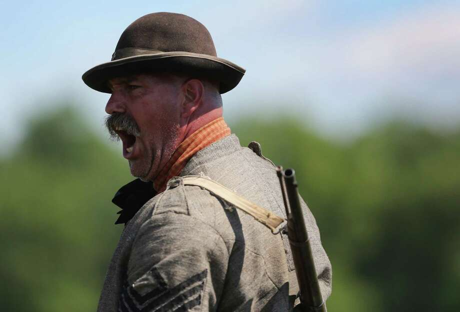 A Confederate re-enactor yells orders during a re-enactment of the Battle of Gettysburg on June 29, 2013 in Gettysburg, Pennsylvania. Some 8,000 re-enactors are participating in events marking the 150th anniversary of the July 1-3, 1863 Battle of Gettysburg, considered the turning point in favor of the Union in the American Civil War. Union and Confederate armies suffered a combined total of some 46,000-51,0000 casualties in the battle, the highest of any conflict of the war. Photo: John Moore, Getty Images / 2013 Getty Images
