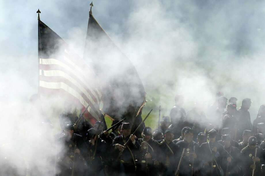 Union reenactors take part in a demonstration of a battle during ongoing activities commemorating the 150th anniversary of the Battle of Gettysburg, Saturday, June 29, 2013, at Bushey Farm in Gettysburg, Pa. Photo: Matt Rourke, Associated Press / AP