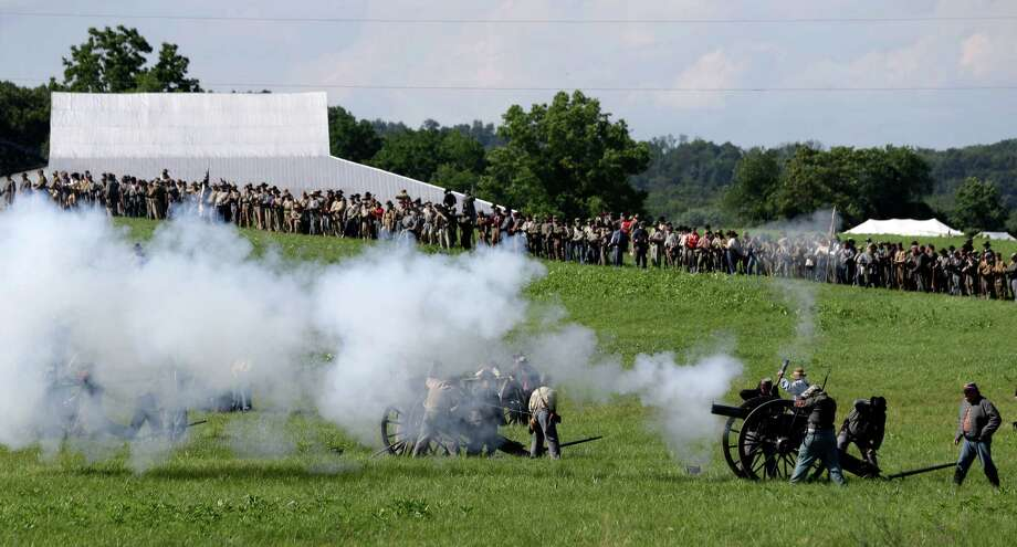Reenactors fire simulated artillery during a demonstration of a battle during ongoing activities commemorating the 150th anniversary of the Battle of Gettysburg, Saturday, June 29, 2013, at Bushey Farm in Gettysburg, Pa. Photo: Matt Rourke, Associated Press / AP