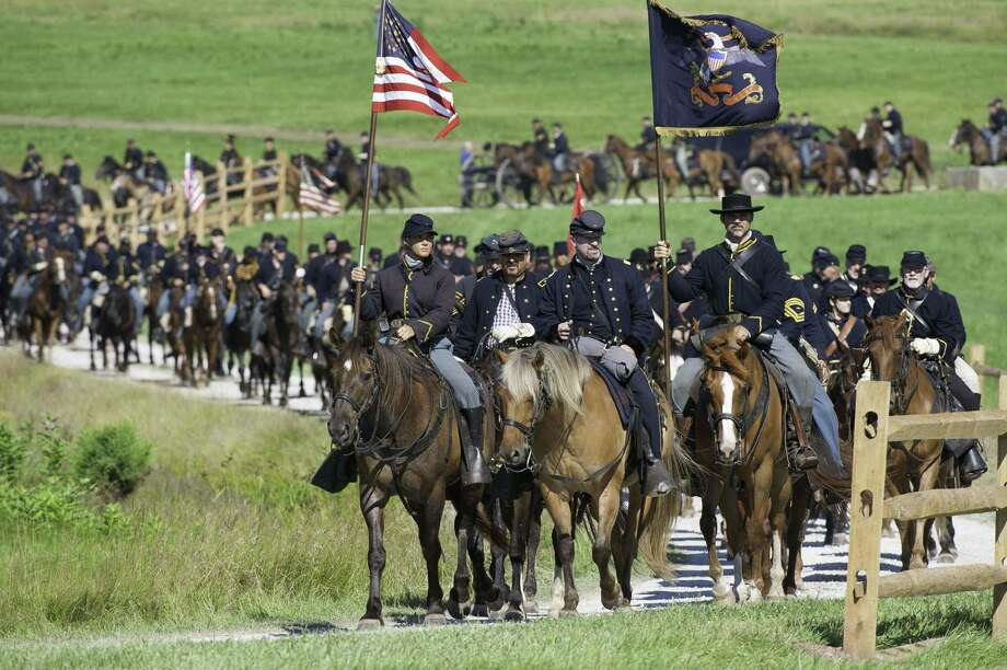 Union Cavalry arrives at the battlefield during a re-enactment of the Battle of Gettysburg on June 29, 2013, at the start of the 150th Gettysburg celebration in Gettysburg, Pennsylvania. Over three days, more than 10,000 re-enactors will pay tribute to the battle that took place in Gettysburg on July 1-3, 1863, during the 1861-1865 US Civil War. Photo: KAREN BLEIER, AFP/Getty Images / AFP