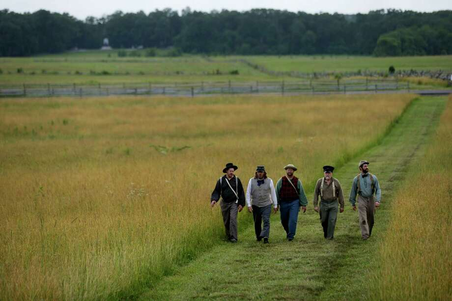 Reenactors portraying Confederate soldiers in the 9th Texas Infantry view the field Pickett's Charge, during ongoing activities commemorating the 150th anniversary of the Battle of Gettysburg, Thursday, June 27, 2013, in Gettysburg, Pa. Photo: Matt Rourke, Associated Press / AP