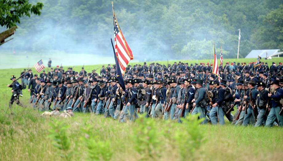 "The 24th Michigan ""Iron Brigade"" prepares to engage the Confederate Army during ongoing activities commemorating the 150th anniversary of the Battle of Gettysburg, Friday, June 28, 2013, at  at Bushey Farm in Gettysburg, Pa.  Union forces turned away a Confederate advance in the pivotal battle of the Civil War fought July 1-3, 1863, which was also the war's bloodiest conflict with more than 51,000 casualties. Photo: Jeremy Long, Associated Press / Lebanon Daily News"