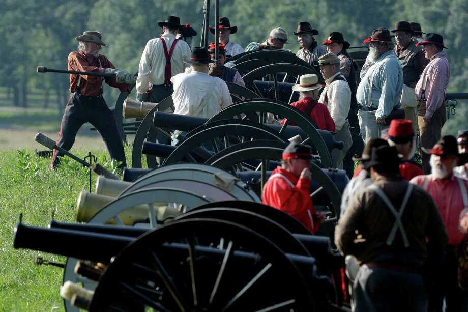 Confederate reenactors prepare for a demonstration of a battle during ongoing activities commemorating the 150th anniversary of the Battle of Gettysburg, Friday, June 28, 2013, at  at Bushey Farm in Gettysburg, Pa. Photo: Matt Rourke, Associated Press / AP