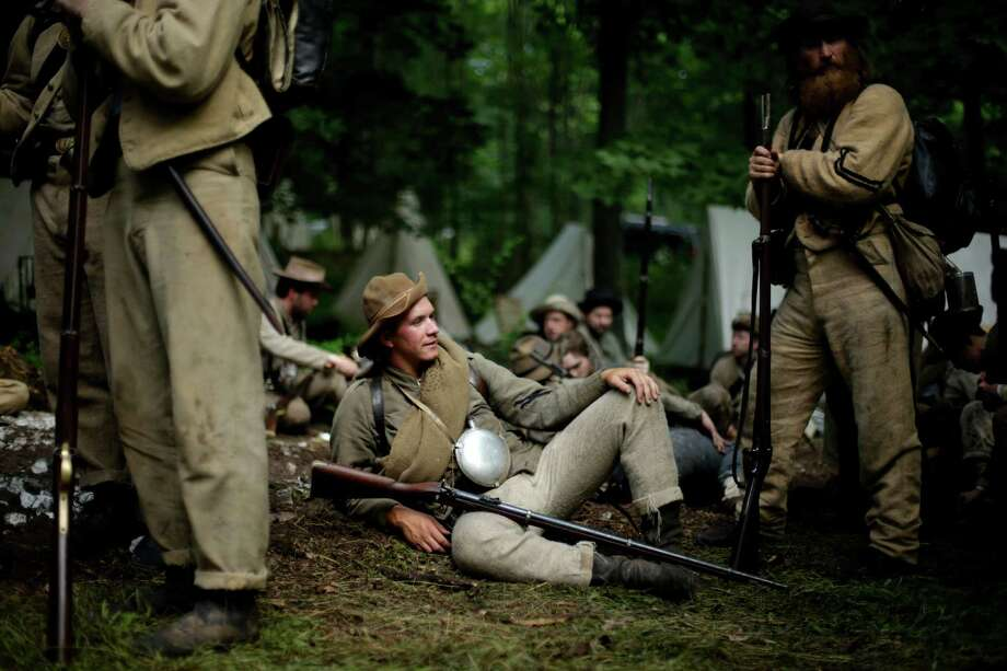 Members of the 1st Tennessee wait to take part in in a demonstration of a battle during ongoing activities commemorating the 150th anniversary of the Battle of Gettysburg, Friday, June 28, 2013, at  at Bushey Farm in Gettysburg, Pa. Photo: Matt Rourke, Associated Press / AP