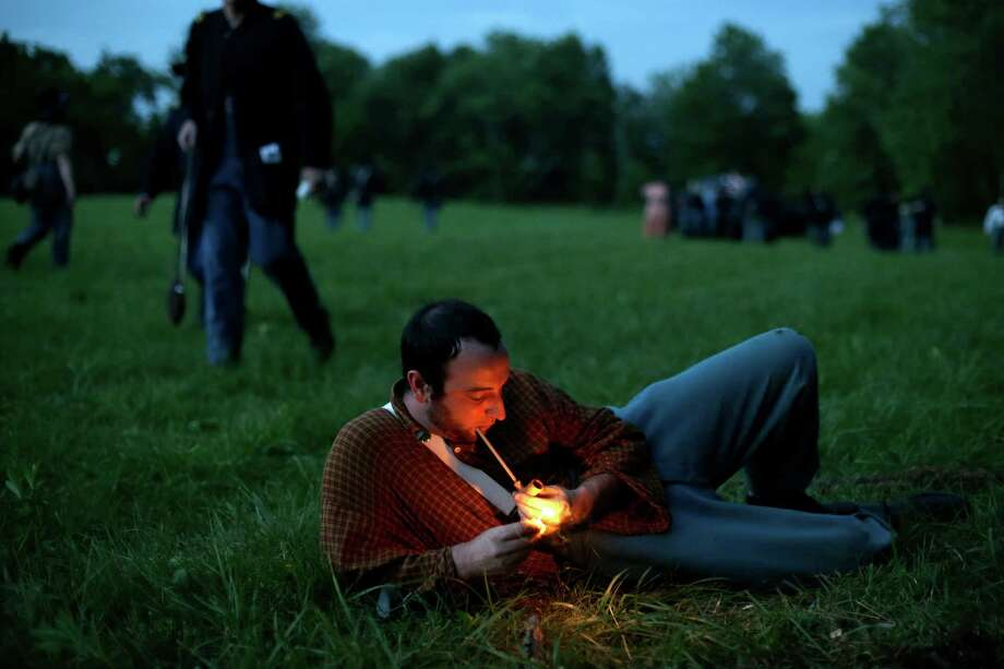 A member of Union's Murray's Brigade lights his pipe during ongoing activities commemorating the 150th anniversary of the Battle of Gettysburg, Thursday, June 27, 2013, at Bushey Farm in Gettysburg, Pa. Photo: Matt Rourke, Associated Press / AP