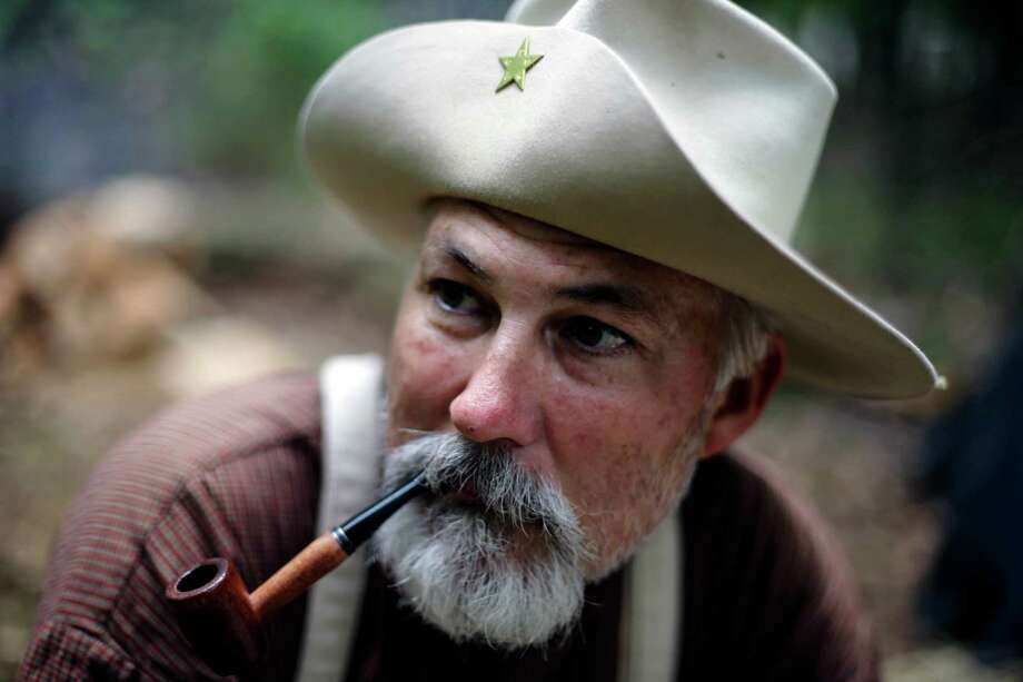 Mike Wilkinson, of San Antonio, portraying a soldier with the 4th Texas Infantry, smokes a pipe during ongoing activities commemorating the 150th anniversary of the Battle of Gettysburg, Thursday, June 27, 2013, in Gettysburg, Pa. Photo: Matt Rourke, Associated Press / AP