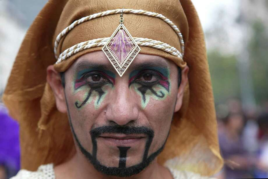 A person in costume pauses for a portrait during the annual Gay Pride Parade in Mexico City, Saturday, June 29, 2013. (AP Photo/Marco Ugarte) Photo: Marco Ugarte, Associated Press / AP