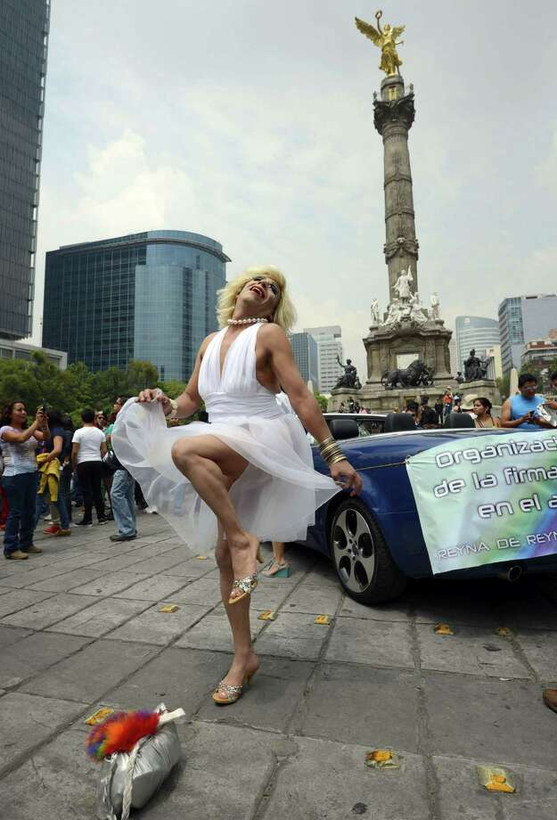 A man dressed as Marilyn Monroe poses during the 35th Gay Pride Parade along Reforma Avenue in Mexico City on June 29, 2013. AFP PHOTO/Alfredo EstrellaALFREDO ESTRELLA/AFP/Getty Images Photo: ALFREDO ESTRELLA, AFP/Getty Images / AFP