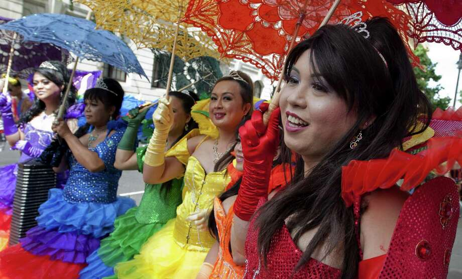 TOPSHOTS Members of the Lesbian, Gay, Bisexual and Transgender (LGBT) community parade in central London during the annual Pride Parade on June 29, 2013. TOPSHOTS/AFP PHOTO/WILL OLIVERWILL OLIVER/AFP/Getty Images Photo: WILL OLIVER, AFP/Getty Images / AFP ImageForum