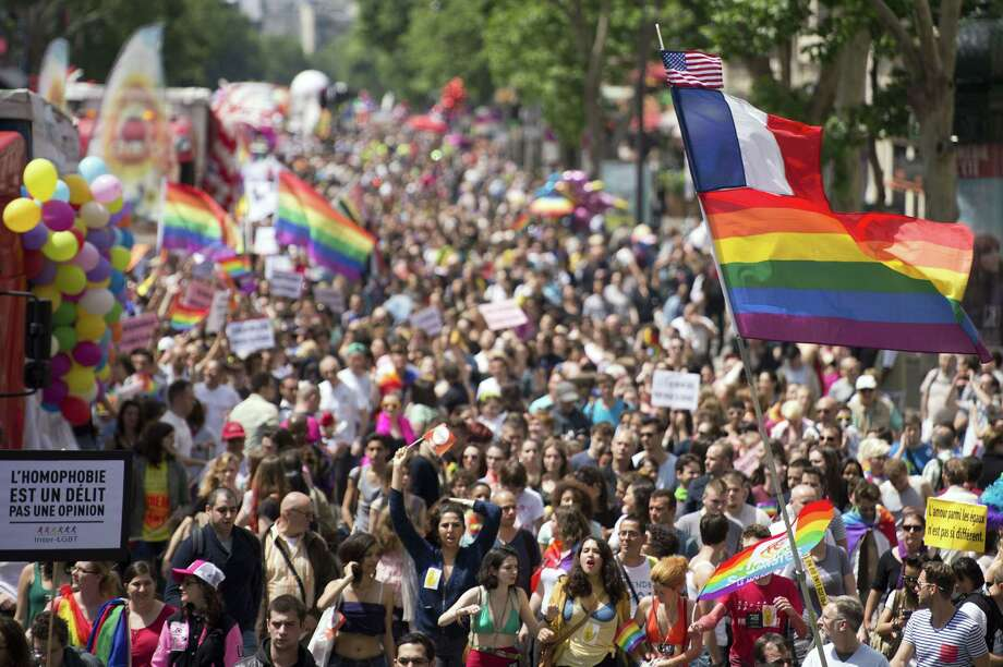 People parade during the homosexual, lesbian, bisexual and transgender (HLBT) visibility march, the Gay Pride, on June 29, 2013 in Paris. AFP PHOTO / LIONEL BONAVENTURELIONEL BONAVENTURE/AFP/Getty Images Photo: LIONEL BONAVENTURE, AFP/Getty Images / AFP