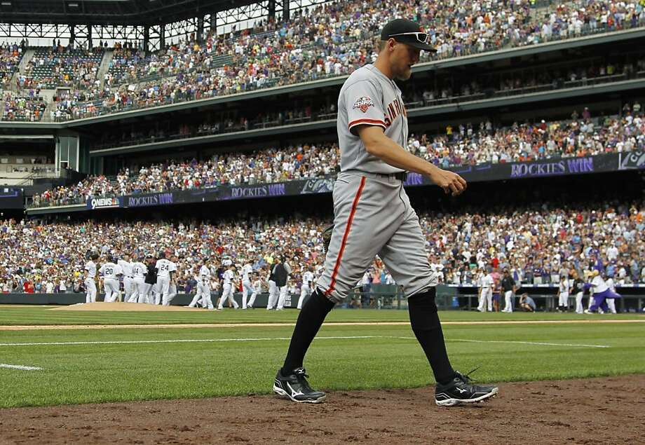 Hunter Pence heads to the dugout as the Rockies celebrate Nolan Arenado's game-winning single off of Jeremy Affeldt. The Giants find themselves in fourth place in the tight NL West. Photo: David Zalubowski, Associated Press