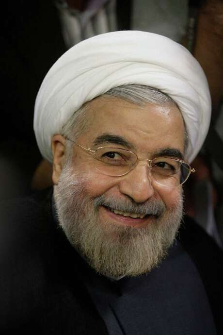 Iran's new leader Hasan Rouhani says his election was a vote for change that he will fulfill. Photo: Vahid Salemi, STR / AP