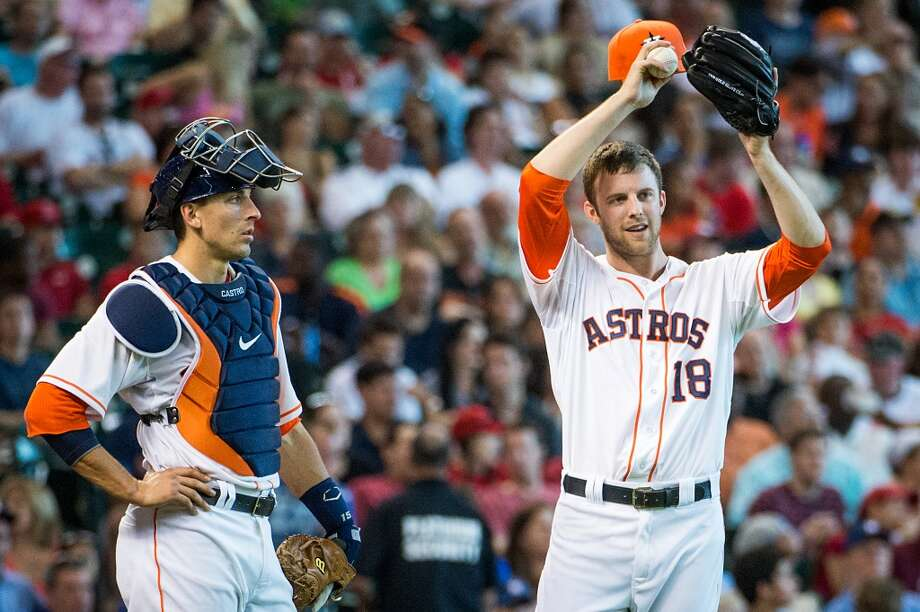 Astros starting pitcher Jordan Lyles and catcher Jason Castro regroup after Lyles hit Howie Kendrick with a pitch during the fourth inning.