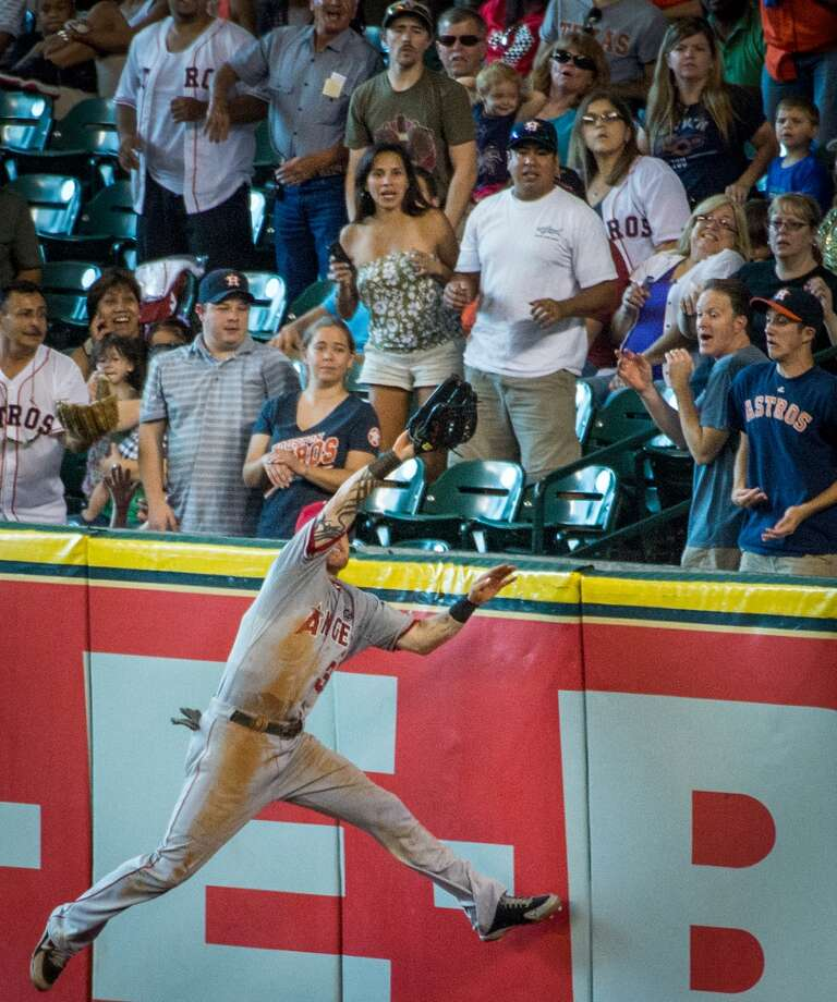 Angels right fielder Josh Hamilton makes a leaping catch over the wall on a ball hit by Astros third baseman Matt Dominguez.