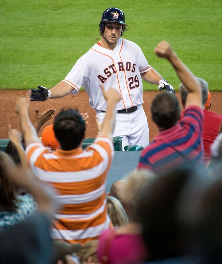 Astros first baseman Brett Wallace celebrates after hitting  a home run during the seventh inning.