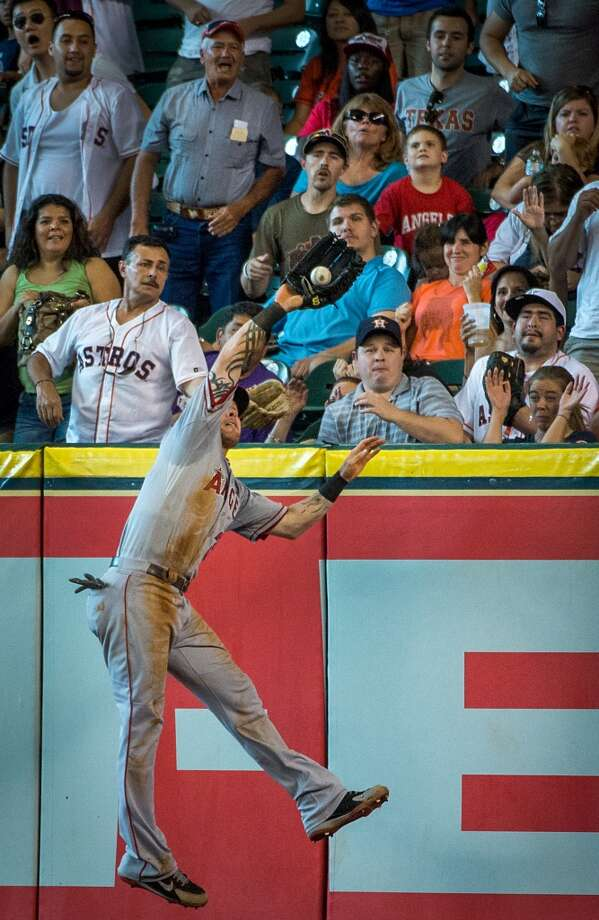 Angels right fielder Josh Hamilton leaps to take a home run away from J.D. Martinez during the fifth inning.