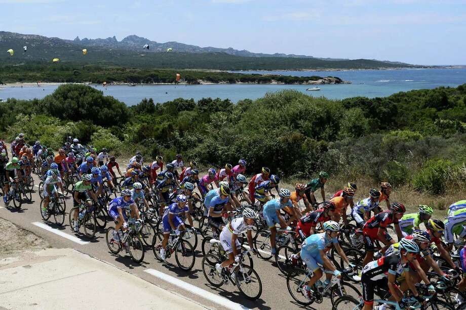 The pack rides during the 213 km first stage of the 100th edition of the Tour de France cycling race on June 29, 2013 between Porto-Vecchio and Bastia, on the French Mediterranean Island of Corsica.  AFP PHOTO / PASCAL GUYOTPASCAL GUYOT/AFP/Getty Images ORG XMIT: 169002044 Photo: PASCAL GUYOT / AFP