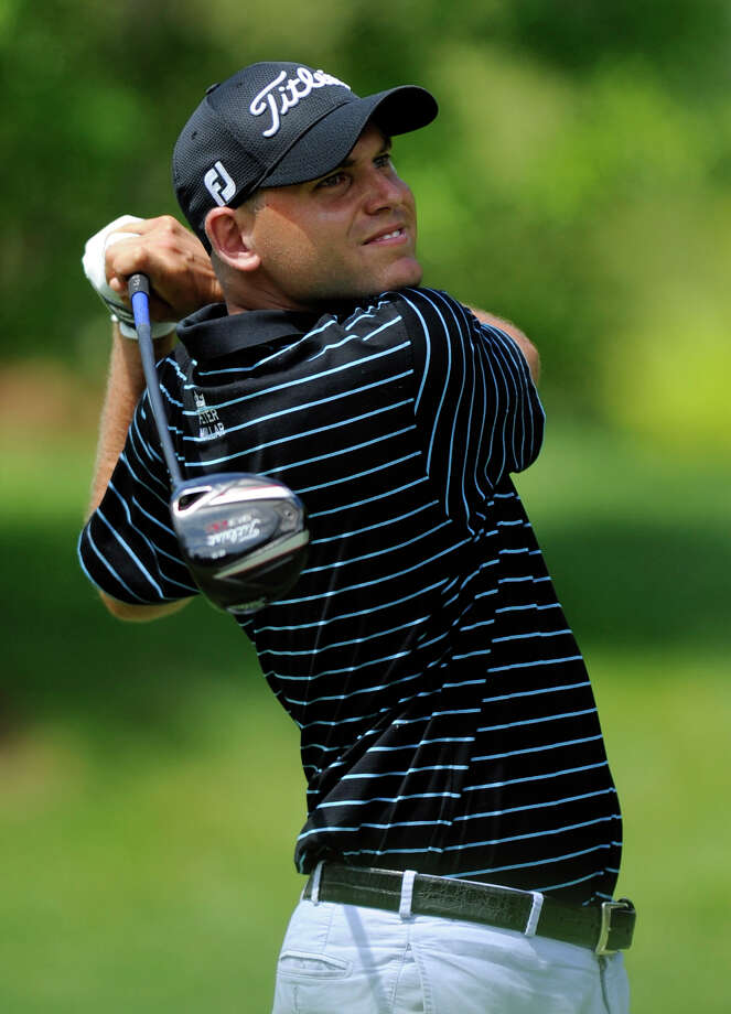 Bill Haas watches his drive from the 11th tee during the third round of the AT&T National golf tournament at Congressional Country Club, Saturday, June 29, 2013, in Bethesda, Md. (AP Photo/Nick Wass) ORG XMIT: MDPS107 Photo: Nick Wass / FR67404 AP