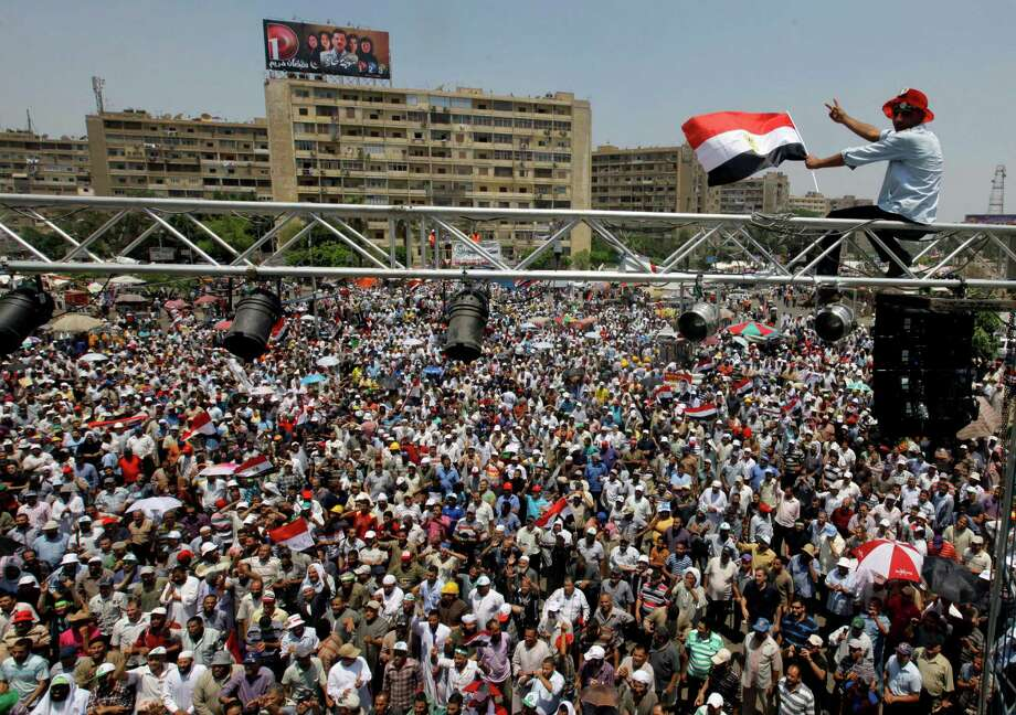 Supporters of Egypt's Islamist President Mohammed Morsi fill a public square in Cairo, not far from the presidential palace, on Saturday, the eve of what are expected to be major opposition protests. Photo: Amr Nabil, STF / AP