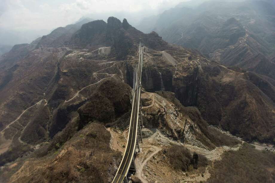The Baluarte Bridge near Concordia, Mexico, on the Durango-Mazatlan Highway is designed to bring people, cargo and legitimate commerce safely through a mountain range known until now for marijuana, opium poppies and an accident-prone road called the Devil's Backbone. Photo: Dario Lopez-Mills / Associated Press