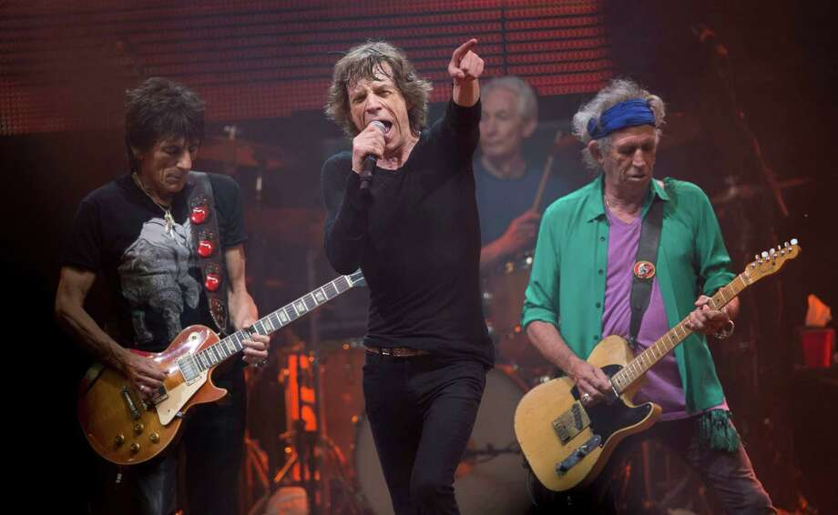 Mick Jagger, center, Ronnie Wood, left ,Charlie Watts, rear on drums and Keith Richards, right, of British band the Rolling Stones, perform on the Pyramid main stage at Glastonbury, England, Saturday, June 29, 2013. Thousands of music fans have arrived for the festival to see headliners, Arctic Monkeys, Mumford and Sons and the Rolling Stones. Photo: Joel Ryan, Associated Press / Invision
