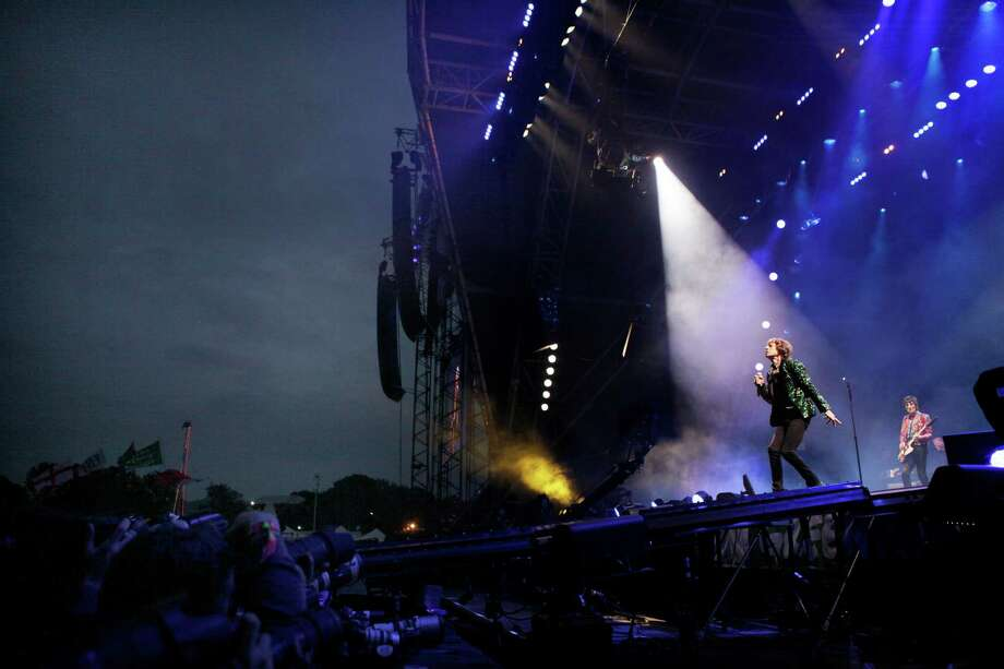 Mick Jagger of The Rolling Stones performs in Glastonbury, England on Saturday, June 29, 2013.  Thousands are to enjoy the three day festival that started on Friday, June 28, 2013 with headliners, Arctic Monkeys, the Rolling Stones and Mumford and Sons. Photo: Jim Ross, Associated Press / Invision