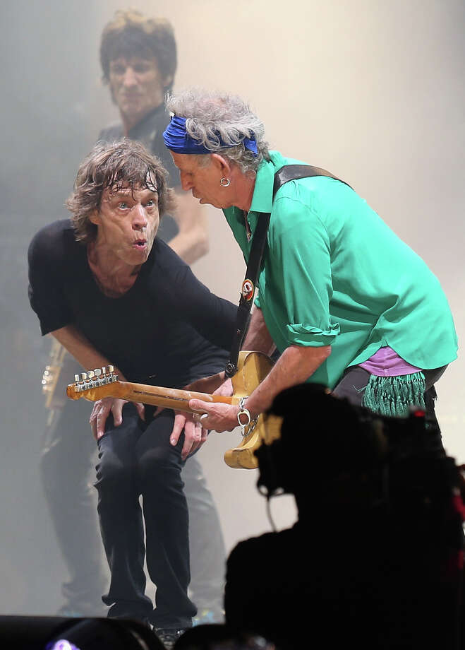 Mick Jagger gestures at Keith Richards of The Rolling Stones as they perform on the Pyramid Stage at Glastonbury Festival 2013 on June 29, 2013 in Glastonbury, England. at the Glastonbury Festival of Contemporary Performing Arts site at Worthy Farm, Pilton on June 29, 2013 near Glastonbury, England. The wholesale market caters for traders throughout the Festival who are estimated to provide 3 million meals for festival goers, crew and performers. Gates opened on Wednesday at the Somerset diary farm that will be playing host to one of the largest music festivals in the world and this year features headline acts Artic Monkeys, Mumford and Sons and the Rolling Stones. Tickets to the event which is now in its 43rd year sold out in minutes and that was before any of the headline acts had been confirmed. The festival, which started in 1970 when several hundred hippies paid 1 GBP to watch Marc Bolan, now attracts more than 175,000 people over five days. Photo: Matt Cardy, Getty Images / 2013 Getty Images
