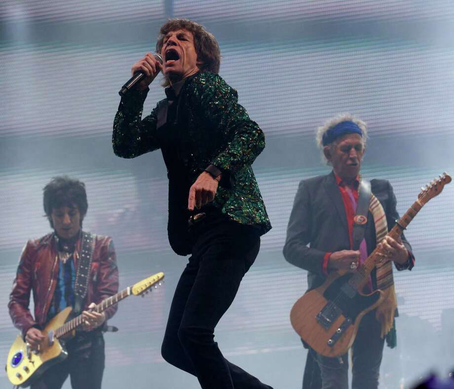 British musicians Mick Jagger (C), Ron Wood (L) and Keith Richards of the Rolling Stones perform on the Pyramid Stage on the fourth day of the Glastonbury Festival of Contemporary Performing Arts near Glastonbury, southwest England, on June 29, 2013. The festival attracts 170,000 party-goers to the dairy farm in Somerset, and this year's tickets sold out within two hours of going on sale. The Rolling Stones are will perform at the festival for the first time. Photo: ANDREW COWIE, AFP/Getty Images / AFP