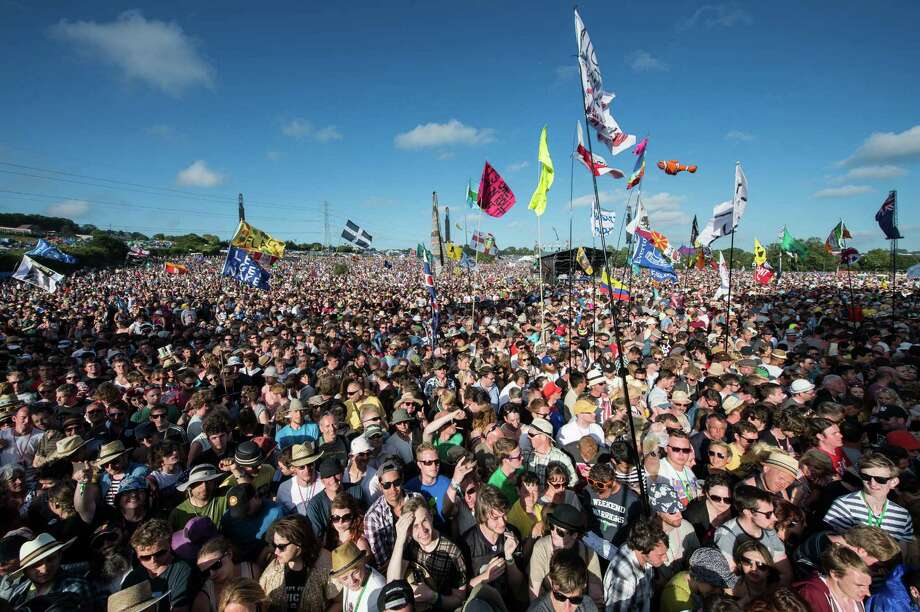 The crowd enjoy the afternoon sunshine before Primal Scream perform on the Pyramid Stage during day 3 of the 2013 Glastonbury Festival at Worthy Farm on June 29, 2013 in Glastonbury, England. Photo: Ian Gavan, Getty Images / 2013 Getty Images