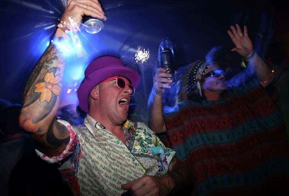 People dance in a nightime venue in the Block 9 area at the Glastonbury Festival of Contemporary Performing Arts site at Worthy Farm, Pilton on June 28, 2013 near Glastonbury, England. Gates opened on Wednesday at the Somerset diary farm that will be playing host to one of the largest music festivals in the world and this year features headline acts Artic Monkeys, Mumford and Sons and the Rolling Stones. Tickets to the event which is now in its 43rd year sold out in minutes and that was before any of the headline acts had been confirmed. The festival, which started in 1970 when several hundred hippies paid 1 GBP to watch Marc Bolan, now attracts more than 175,000 people over five days. Photo: Matt Cardy, Getty Images / 2013 Getty Images