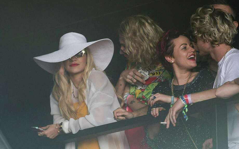 Rita Ora and Jamie Winstone look on as Primal Scream performs on the Pyramid Stage during day 3 of the 2013 Glastonbury Festival at Worthy Farm on June 29, 2013 in Glastonbury, England. Photo: Ian Gavan, Getty Images / 2013 Getty Images