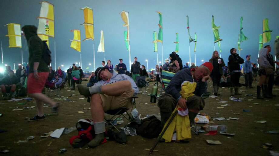Festivalgoer's sleep near the Other Stage during the third day of the Glastonbury Festival of Contemporary Performing Arts near Glastonbury, southwest England, on June 28, 2013. The festival attracts 170,000 party-goers to the dairy farm in Somerset, and this year's tickets sold out within two hours of going on sale. The Rolling Stones will perform at the festival for the first time, headlining on Saturday night. Photo: ANDREW COWIE, AFP/Getty Images / AFP