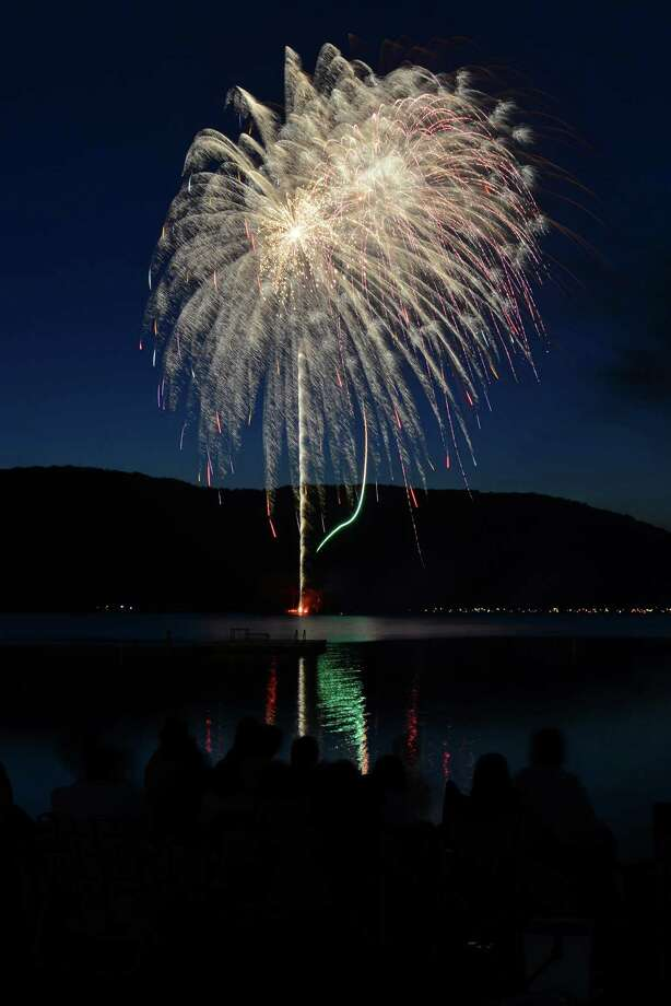 Hundreds of people crowd the beach at Candlewood Park to watch the July 4th fireworks display over Candlewood Lake in Danbury, Conn. on Saturday, June 29, 2013. Photo: Tyler Sizemore / The News-Times